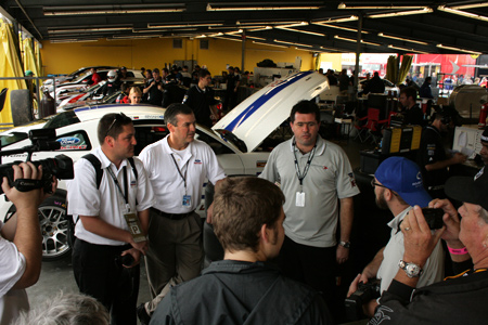 Mike Laney, Mark Wilson of Ford Racing, and Marcus Haselgrove of Starworks Motorsports.
