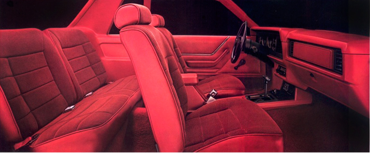 1985 Mustang interior in Canyon red. This is another example of the entirely unhealthy obsession the automotive public and/or Detroit had with Pimp-Red interiors. Whiskey-Tango-Foxtrot?
