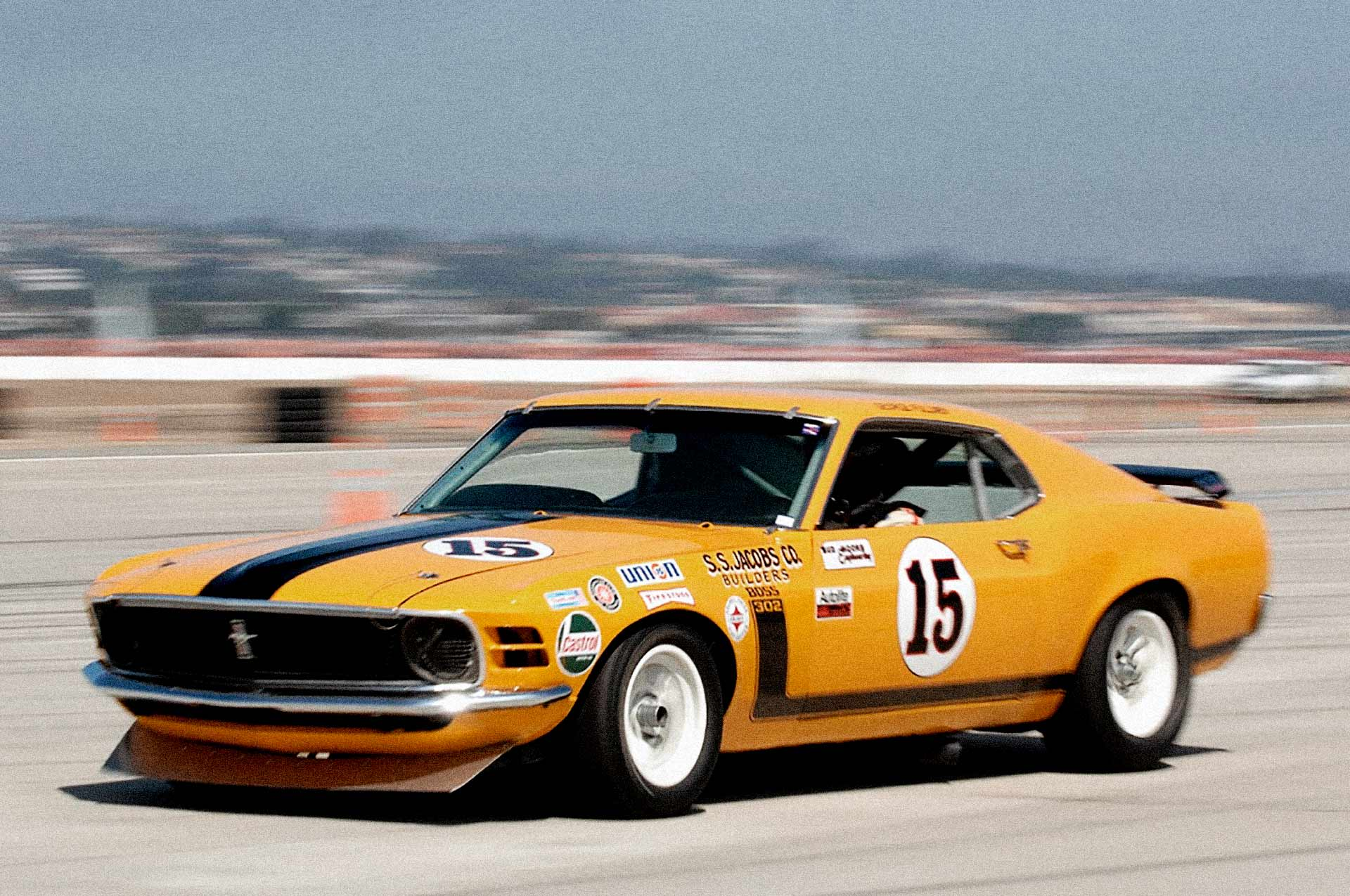 Vintage racer wearing the livery of the TransAm championship winning car of Parnelli Jones.